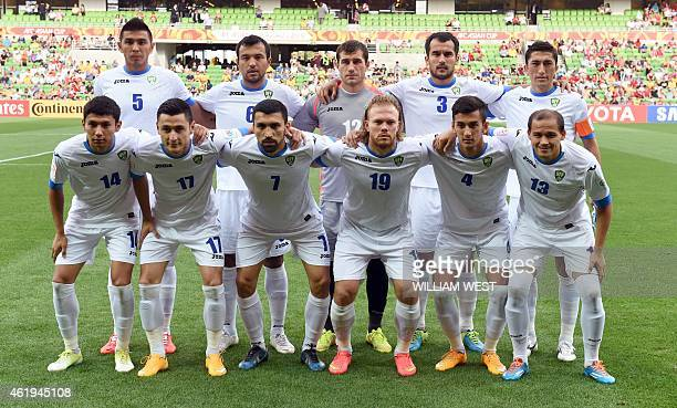 The Uzbekistan football team pose for a photo before the quarterfinal football match between South Korea and Uzbekistan at the AFC Asian Cup in...