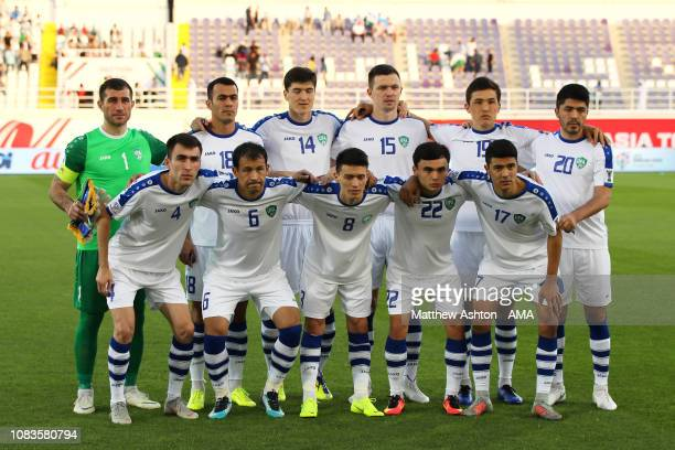 The Uzbekistan players line up for a team photo prior to the AFC Asian Cup Group F match between Japan and Uzbekistsn at Khalifa Bin Zayed Stadium on...