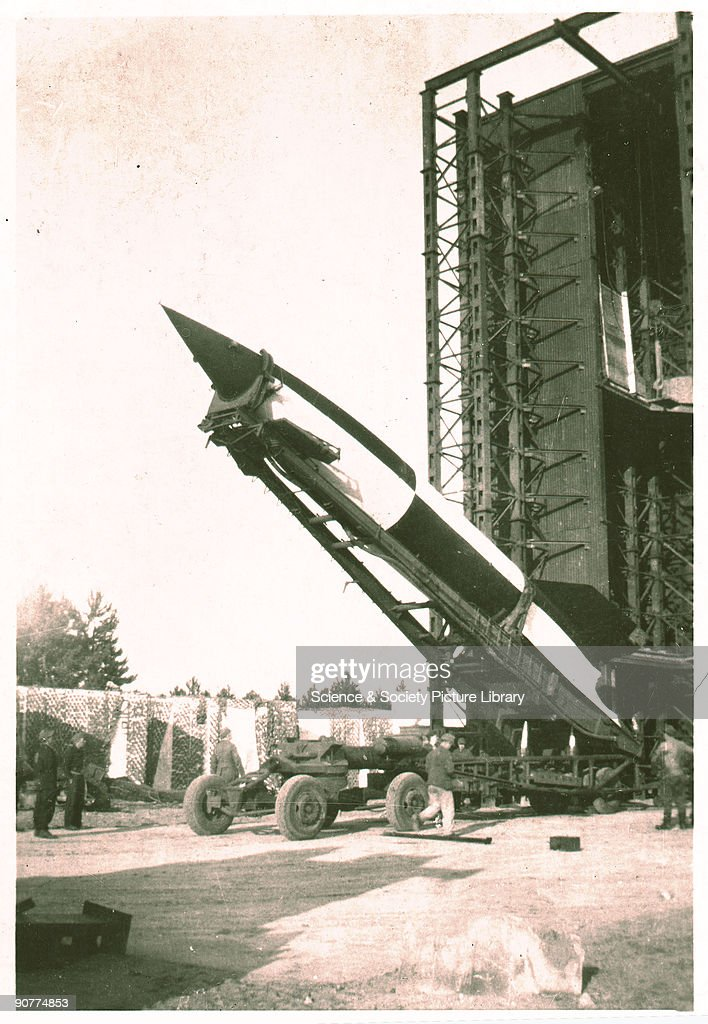 The V2 rocket was developed at the German Rocket Test Centre at Peenemunde by a team led by Wernher von Braun (1912-1977), and first successfully tested in 1942. Over 3000 of the missiles were fired at targets in Britain and the Low Countries in 1944-1945. The V2 was propelled by a rocket engine which used alcohol and liquid oxygen as fuel. Operation Backfire was a British post-World War II operation designed to evaluate the V2 rocket system. The tests were undertaken in the months after the fall of Nazi Germany at a gun testing range at Cuxhaven, in the British zone of occupation, using 8 complete rockets, all of which were painted black and white. Captured German firing troops and rocket scientists were employed in the operation.