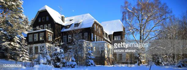 The vacant building of the former 'Heinrich Heine Hotel' is covered in snow in the village centre of Schierke Germany 18 January 2016 The hotel was...