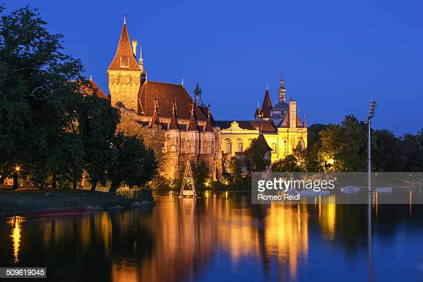 The Vajdahunyad castle in Budapest City Park at the blue hour reflecting in the boating lake