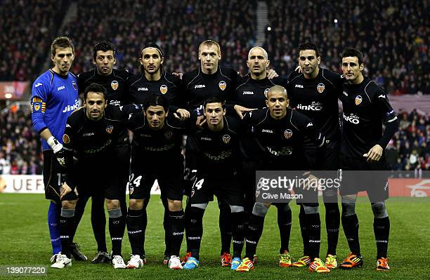 The Valencia CF players line up for a team photo prior to the UEFA Europa League Round of 32 First leg match between Stoke City and Valencia CF at...