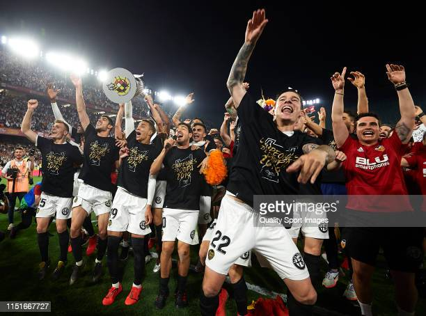 The Valencia team celebrate winning the cup during the Spanish Copa del Rey match between FC Barcelona and Valencia CF at Estadio Benito Villamarin...