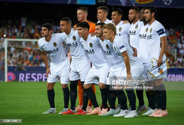 The Valencia team line up for a photo prior to kick off during the Group H match of the UEFA Champions League between Valencia and Juventus at...