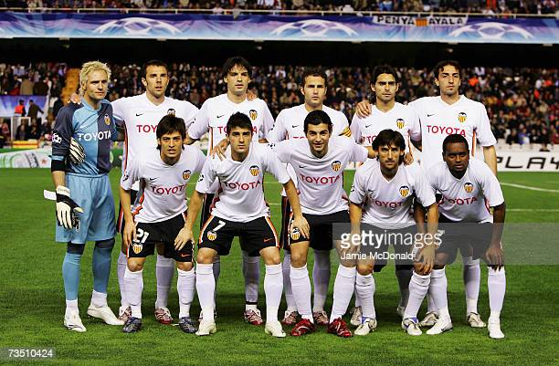 The Valencia team poses for a group photograph during the UEFA Champions League last of sixteen, second leg match between Valencia and Inter Milan on...