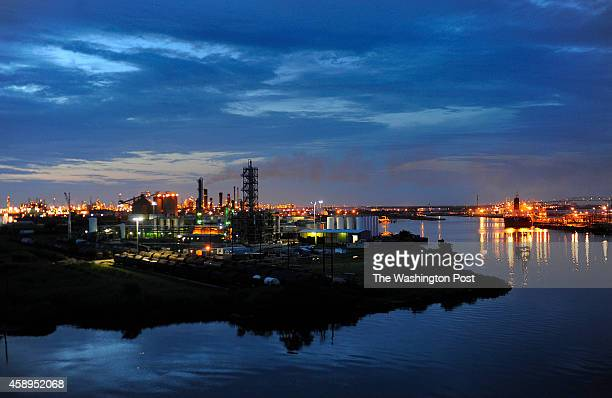 The Valero refinery works glow in the dusk light in Port Arthur Texas Port Arthur Texas is the end of the line for oil that would travel through the...