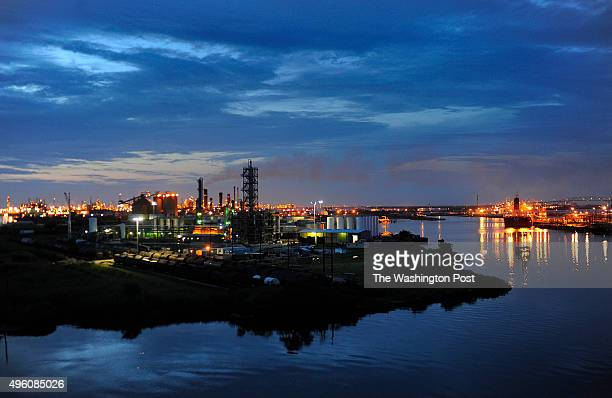 The Valero refinery works glow in the dusk light in Port Arthur, Texas. Port Arthur, Texas is the end of the line for oil that would travel through...