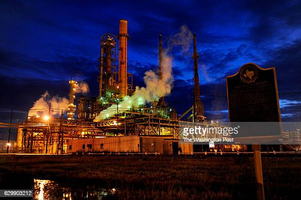 The Valero refinery works glow in the dusk light in Port Arthur, Texas. The state of Texas has placed a historical plaque noting that this area is...