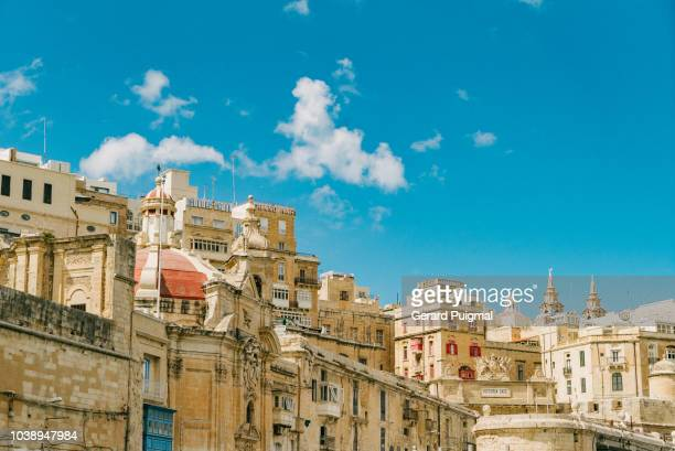 the valletta waterfront skyline seen from a boat - マルタ島 ストックフォトと画像