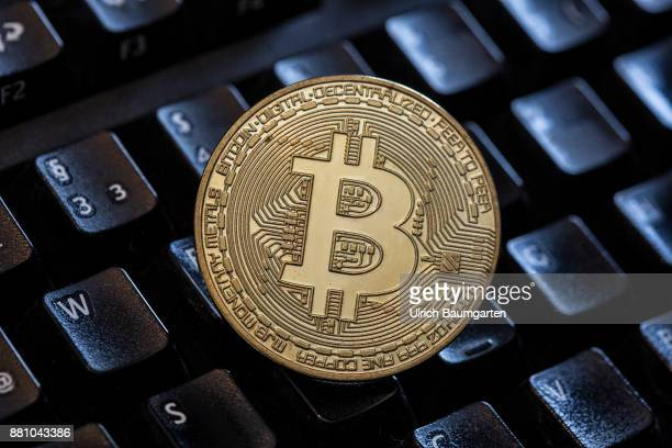 The value of Bitcoin goes up and up The photo shows a Bitcoin on a computer keyboard