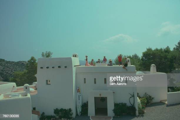 The Valveken family dining on the roof of their home Can Serretas in Ibiza Spain 1989