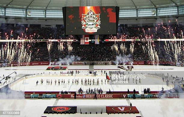 The Vancouver Canucks and the Ottawa Senators shake hands at the finish of the 2014 Tim Hortons NHL Heritage Classic at BC Place Stadium March 2,...