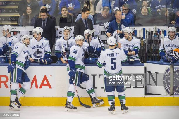 The Vancouver Canucks bench and players during a pause in the regular season NHL game between the Vancouver Canucks and the Toronto Maple Leafs on...