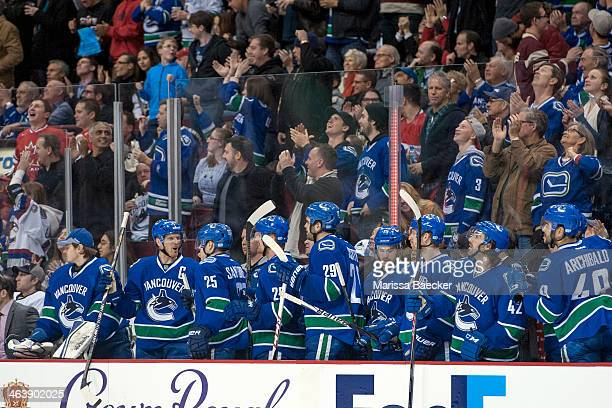 The Vancouver Canucks' bench celebrates a goal against the Pittsburgh Penguins on January 7, 2014 at Rogers Arena in Vancouver, British Columbia,...