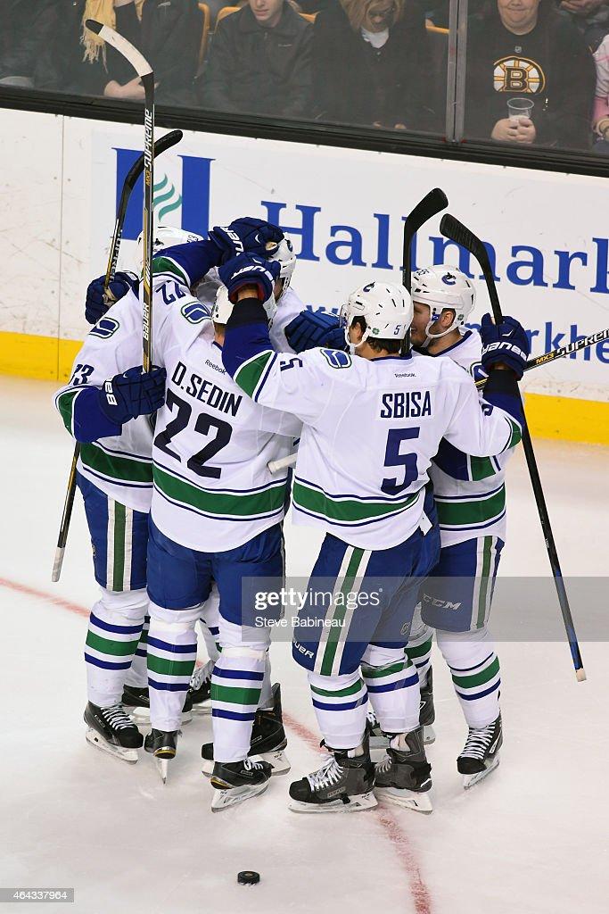 The Vancouver Canucks celebrate a goal against the Boston Bruins at the TD Garden on February 24, 2015 in Boston, Massachusetts.