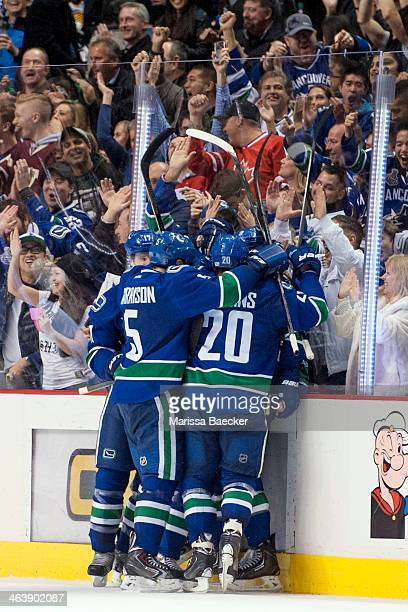 The Vancouver Canucks celebrate a goal with the fans against the Pittsburgh Penguins on January 7, 2014 at Rogers Arena in Vancouver, British...