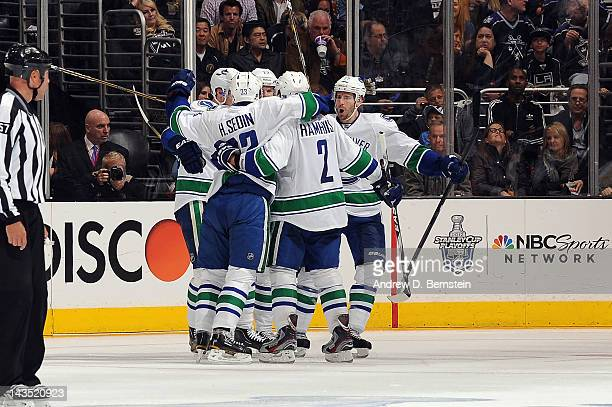 The Vancouver Canucks celebrate after a goal against the Los Angeles Kings in Game Four of the Western Conference Quarterfinals during the 2012 NHL...