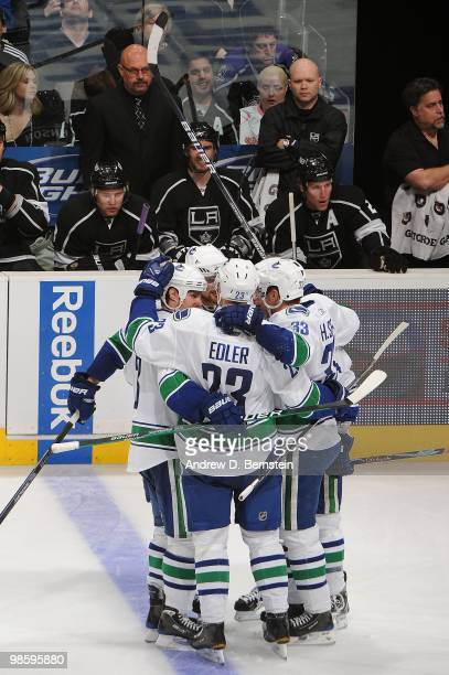 The Vancouver Canucks celebrate after a goal against the Los Angeles Kings in Game Three of the Western Conference Quarterfinals during the 2010 NHL...