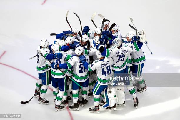 The Vancouver Canucks celebrate their 54 win on a goal by Christopher Tanev at 11 in overtime to defeat the Minnesota Wild in Game Four and the...