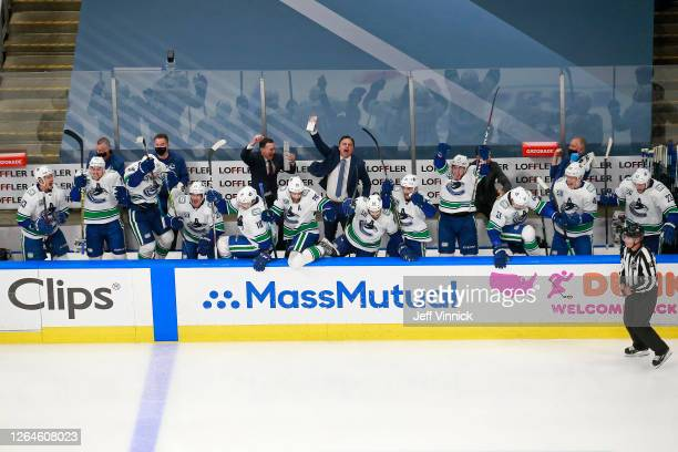 The Vancouver Canucks celebrate their 5-4 win on a goal by Christopher Tanev at :11 in overtime to defeat the Minnesota Wild in Game Four and the...