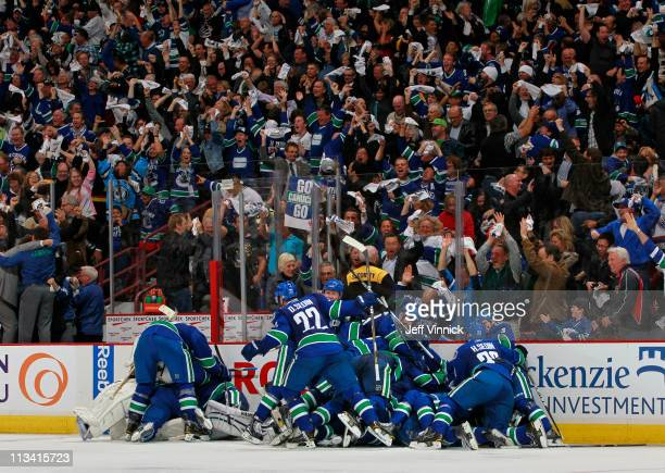 The Vancouver Canucks celebrate their win in Game Seven of the Western Conference quarterfinal against the Chicago Blackhawks during the 2011 NHL...