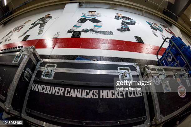 The Vancouver Canucks equipment container stands below the mural of former Kelowna Rockets' players during the last preseason game against the...