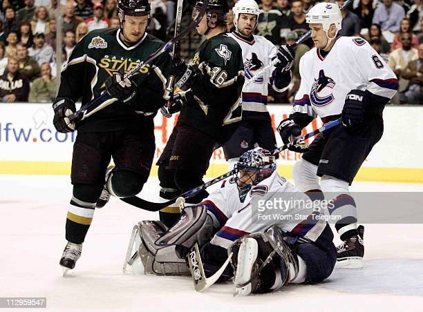 The Vancouver Canucks goalie Robero Luongo covers up the puck in the first period against the Dallas Stars in Game 3 of the first round of the NHL...