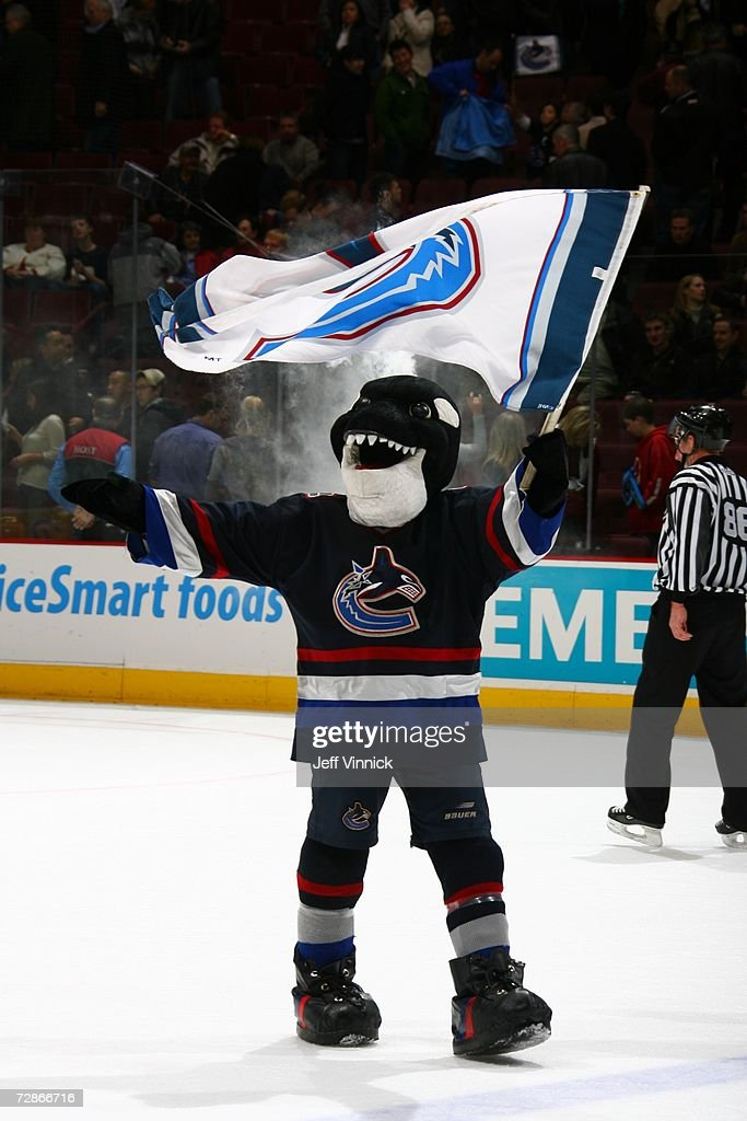 The Vancouver Canucks mascot Fin waves a flag on the ice before the game against the Phoenix Coyotes at General Motors Place on December 12, 2006 in Vancouver, British Columbia, Canada. The Canucks won 5-2.