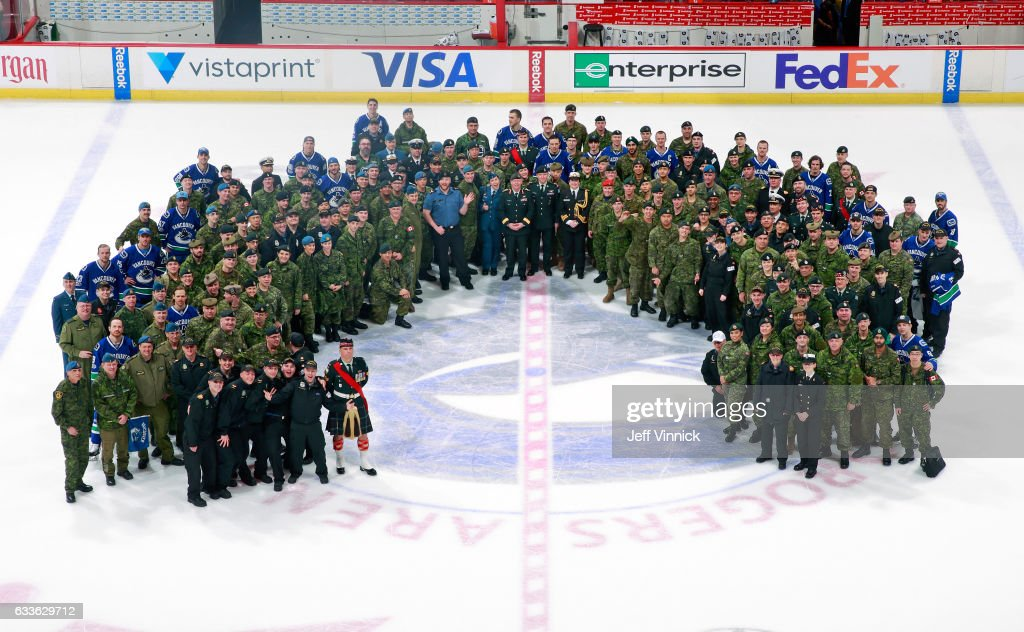 The Vancouver Canucks pose for a group photo with Canadian military after their NHL game against the San Jose Sharks at Rogers Arena February 2, 2017 in Vancouver, British Columbia, Canada.