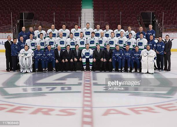 The Vancouver Canucks pose for their official team photo at Rogers Arena on March 17 2011 in Vancouver British Columbia Canada Front Row Cory...