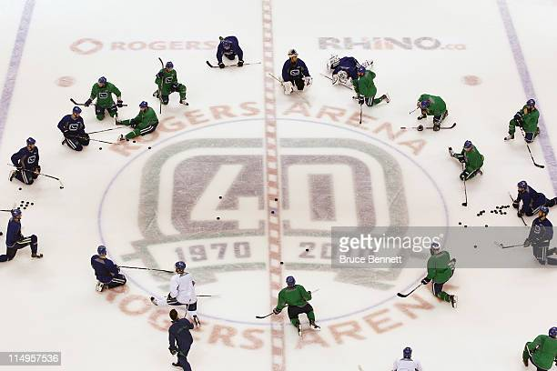 The Vancouver Canucks stretch during a practice session the day before the opening game of the 2011 NHL Stanley Cup Finals at the Rogers Arena on May...