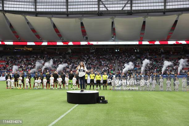 The Vancouver Whitecaps and Atlanta United FC stand on the field while the anthems are sung at BC Place during their match at BC Place on May 15,...