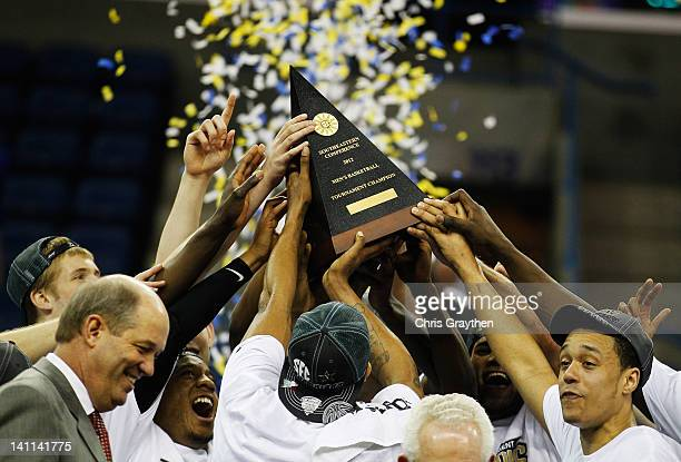 The Vanderbilt Commodores celebrate with the trophy after their 71 to 64 win over the Kentucky Wildcats in the championship game of the 2012 SEC...