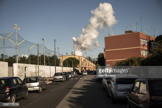 The vapors of the batteries in the Ilva steel plant can be seen from the nearby Tamburi district on December 10 2017 in Taranto Italy The Ilva steel...
