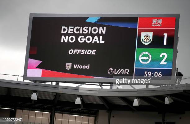 The VAR decision for the disallowed goal of Jay Rodriguez of Burnley is seen on the screens in the stadium during the Premier League match between...
