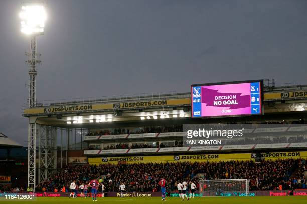 The VAR decision of 'No Goal' is shown on the scoreboard after Crystal Palace's English defender James Tomkins has the ball in the net during the...