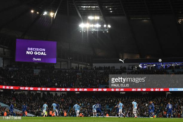 The VAR decision of 'No Goal' is shown on the scoreboard after Sterling thinks he's scored their third goal during the English Premier League...