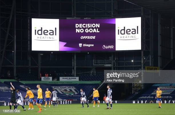 The VAR decision to disallow a goal scored by Mbaye Diagne of West Bromwich Albion for offside is displayed on the LED board during the Premier...