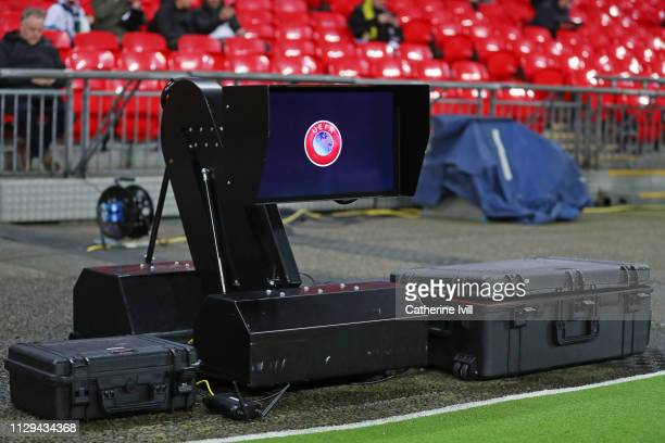 The VAR monitor is seen pitchside before the UEFA Champions League Round of 16 First Leg match between Tottenham Hotspur and Borussia Dortmund at...