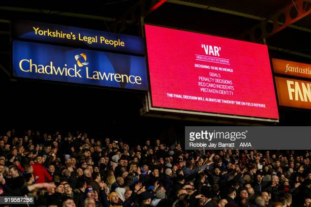 The VAR review system is seen on the LCD screen at The John Smiths Stadium home stadium of Huddersfield Town which result in a disallowed goal during...