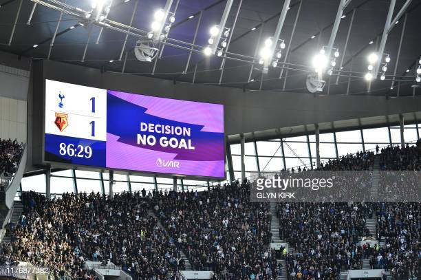 The VAR screen displays an incorrect decision as Tottenham Hotspur's English midfielder Dele Alli scores his team's first goal during the English...