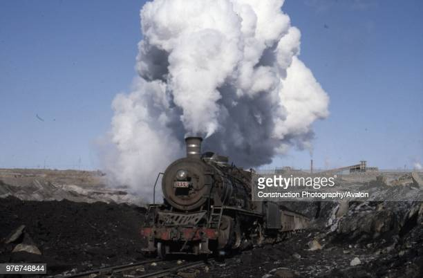 The vast opencast coal mine at Manzhouli in Inner Mongolia on the Russian border in north east China The coal and spoil is bought out by steam trains...
