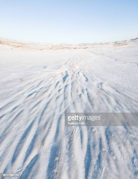 the vast territory of the ice surface of land with white snow, aerial view - snowfield stock pictures, royalty-free photos & images