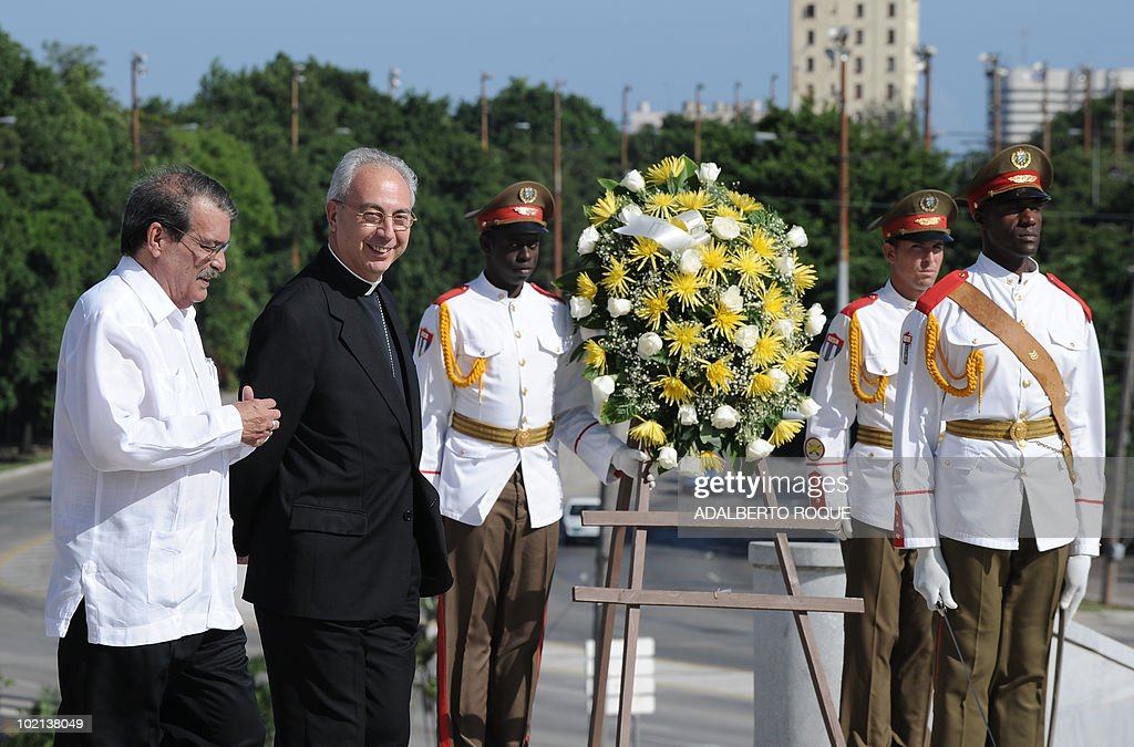 The Vatican Secretary for Relations with States, Monsignor Dominique Francois Joseph Mamberti (2nd L), attends a wreath-layer ceremony at Jose Marti monument with Cuban Foreign vice minister Abelardo Moreno (L), in Havana on June 16, 2010. Mamberti is in a five-day official visit to the island. AFP PHOTO/Adalberto ROQUE