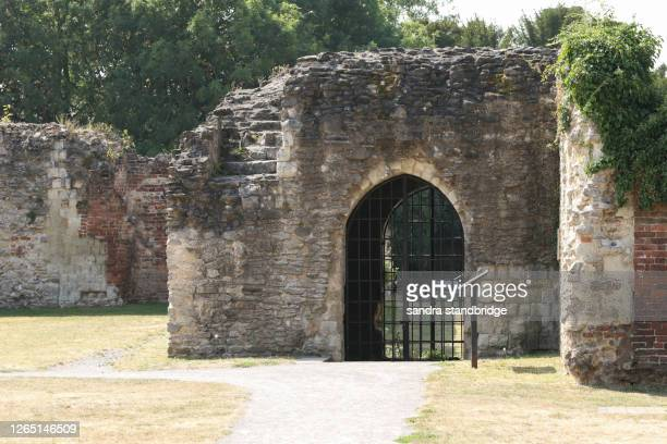 the vaulted cloister passage, of late 12th century date in the waltham abbey gardens, waltham abbey. - stone material stock pictures, royalty-free photos & images