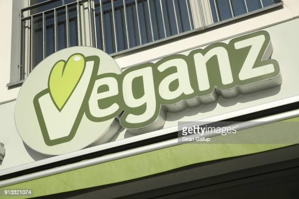 The Veganz logo hangs over the entrance to a Veganz vegan grocery store on February 2 2018 in Berlin Germany Veganz has three stores in Berlin and...