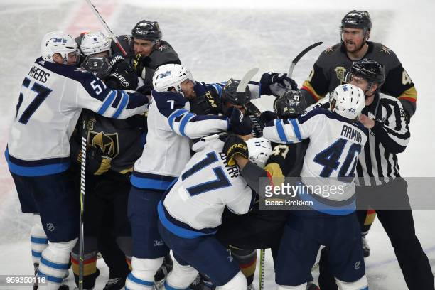 The Vegas Golden Knights and the Winnipeg Jets fight after the final whistle of Game Three of the Western Conference Finals during the 2018 NHL...