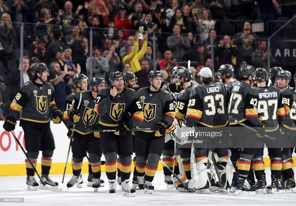 The Vegas Golden Knights celebrate on the ice after David Perron #57 scored the game-winning goal against the Buffalo Sabres in overtime at T-Mobile Arena on October 17, 2017 in Las Vegas, Nevada. The Golden Knights won 5-4 in overtime.