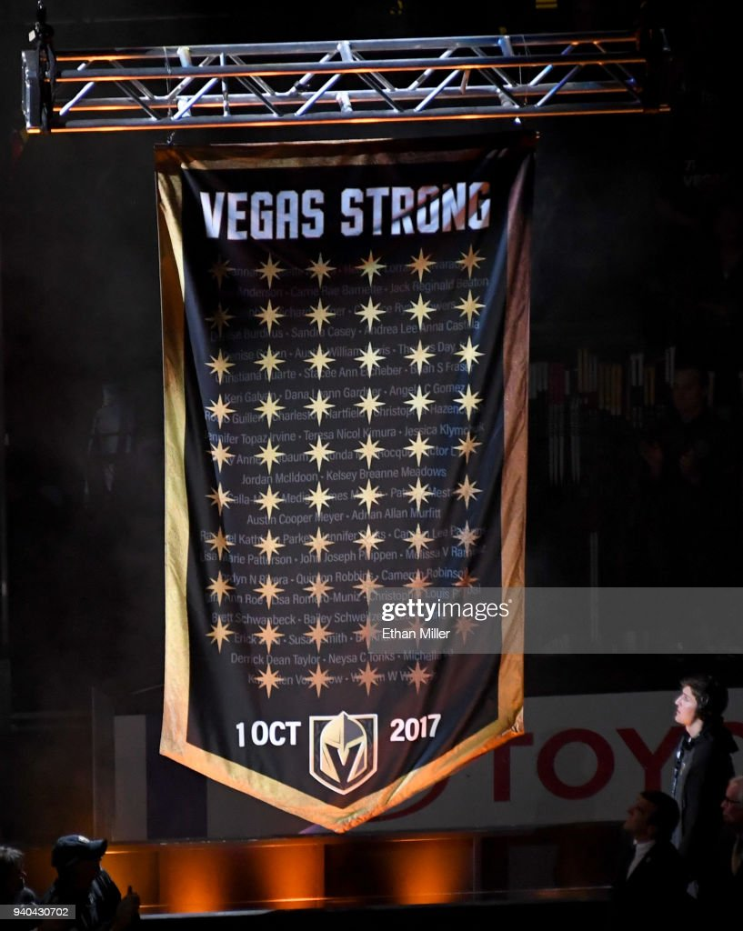 The Vegas Golden Knights hang a banner in the rafters with 58 stars and the names of all the victims of the October 1, 2017 mass shooting in Las Vegas as they retire the number 58 in honor of the 58 victims before a game against the San Jose Sharks at T-Mobile Arena on March 31, 2018 in Las Vegas, Nevada.