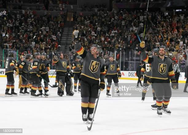The Vegas Golden Knights, including Jonathan Marchessault and Alec Martinez, celebrate the team's 6-2 victory over the Minnesota Wild in Game Seven...